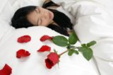 rose pettals on bed