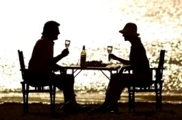 couple having dinner at the ocean