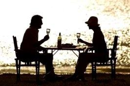 couple on the beach having dinner